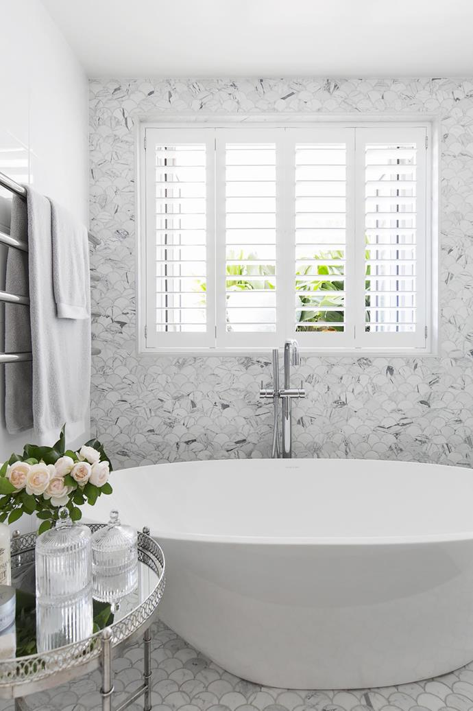Scalloped marble tiles in the bathroom.