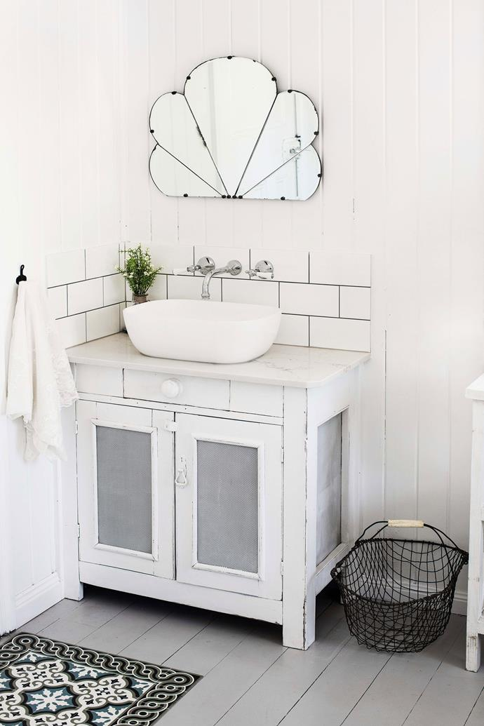 Sandy's favourite op-shop find in the home is the art-deco style mirror in above the bathroom vanity.