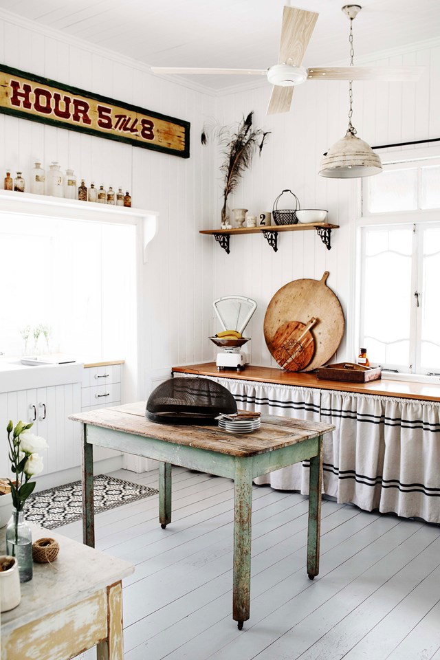"""While contemporary French provincial kitchens will usually share a handful of similarities, it's the kind of style that really requires one-of-a-kind furniture. Achieve this by hunting down antiques, salvaging vintage décor and perhaps forgoing cabinetry altogether for a set of curtains! This is [renovated Queenslander in Bundaberg](https://www.homestolove.com.au/queenslander-white-interior-colour-scheme-19786