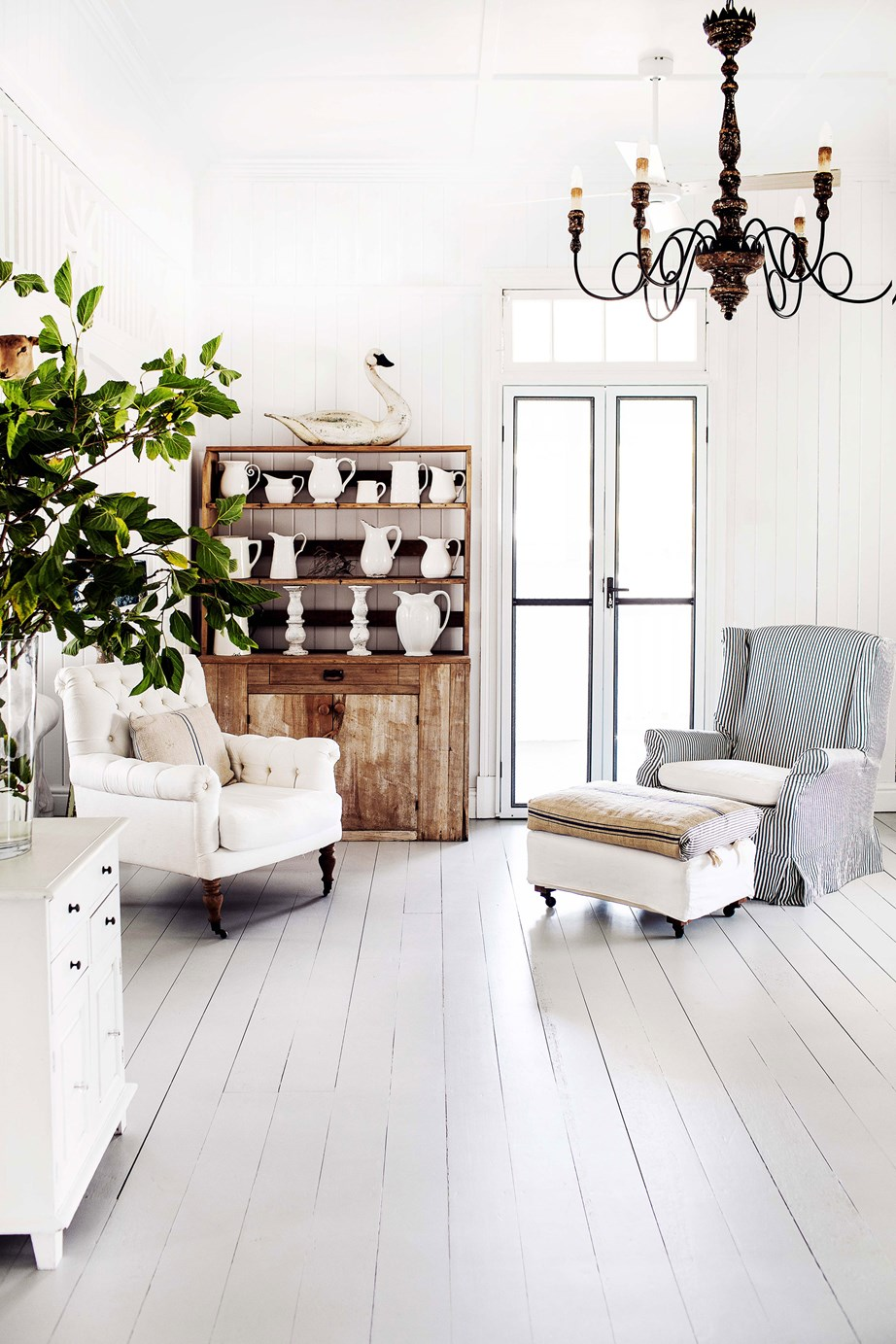 "Lashings of white paint and rooms filled with restored antique furniture, vintage decor and ornate chandeliers, give this [renovated Queenslander home](https://www.homestolove.com.au/queenslander-white-interior-colour-scheme-19786|target=""_blank"") a French provincial feel."