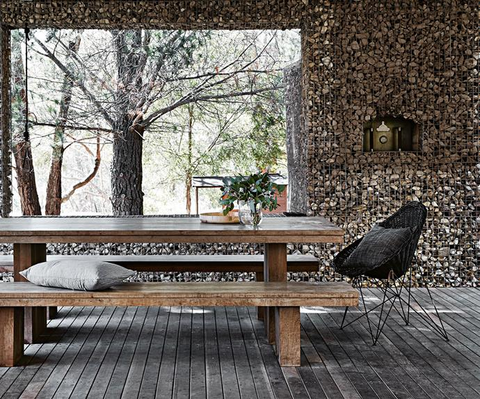 Outdoor dining space with gabion wall