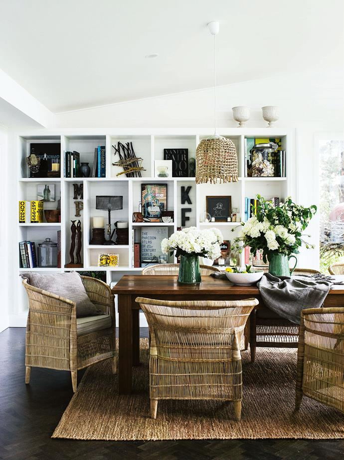 "Michael and Patsy have blended rustic country and [Hamptons style](https://www.homestolove.com.au/how-to-get-the-hamptons-look-3523|target=""_blank"") with tribal elements that draw on Michael's heritage (he's originally from Zimbabwe). In the dining room, a lampshade by Harriet Goodall and Natalie Wilson hangs above a bespoke table by Graham Zealey of Moss Vale's [Southern Trade Supplies](http://www.strade.com.au/