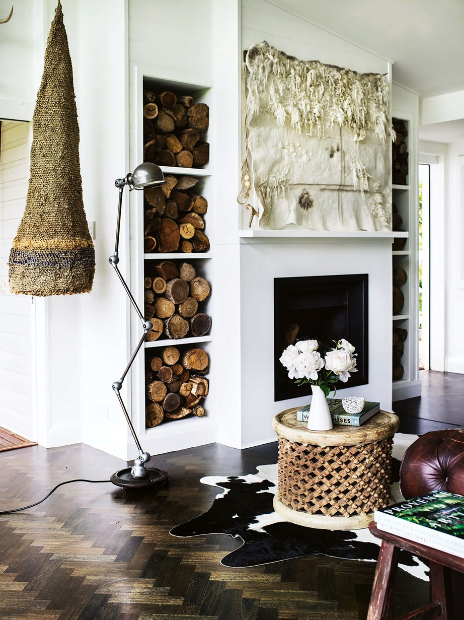 "In the living room of this [Southern Highlands cottage](https://www.homestolove.com.au/cottage-glass-extension-13650|target=""_blank""), a woven artwork by local artist Brook Munro hangs beside an antique French floor lamp, while a felt piece by Harriet Goodall, also a local, neatly conceals the television."