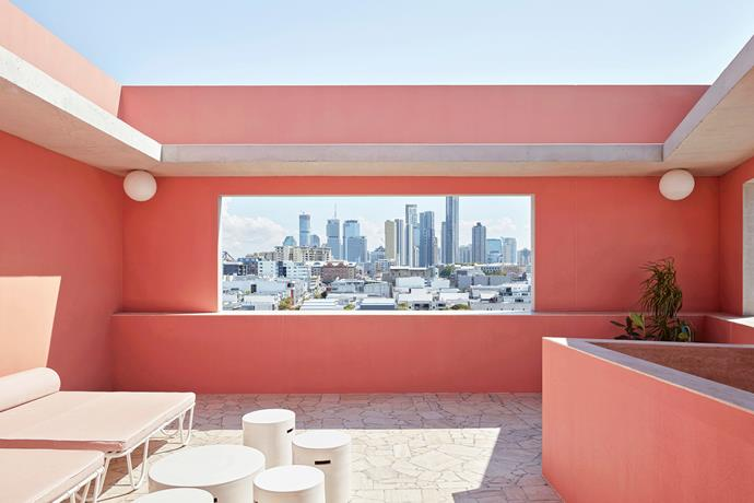 Sitting under the sultry Queensland sky on a private rooftop terrace painted flushed rosé, you'll feel as though you're in another world. The only hint at your true location is a framed view of the cityscape.
