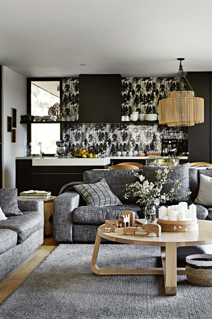 """Bespoke sofas and a 'Jade' coffee table from [Zuster](https://zuster.com.au/ target=""""_blank"""" rel=""""nofollow"""") take pride of place in the living room. In the kitchen, the spashback is 'Fir Tree' wallpaper from [Ferm Living](https://www.fermliving.com/ target=""""_blank"""" rel=""""nofollow"""") with a glass cover."""