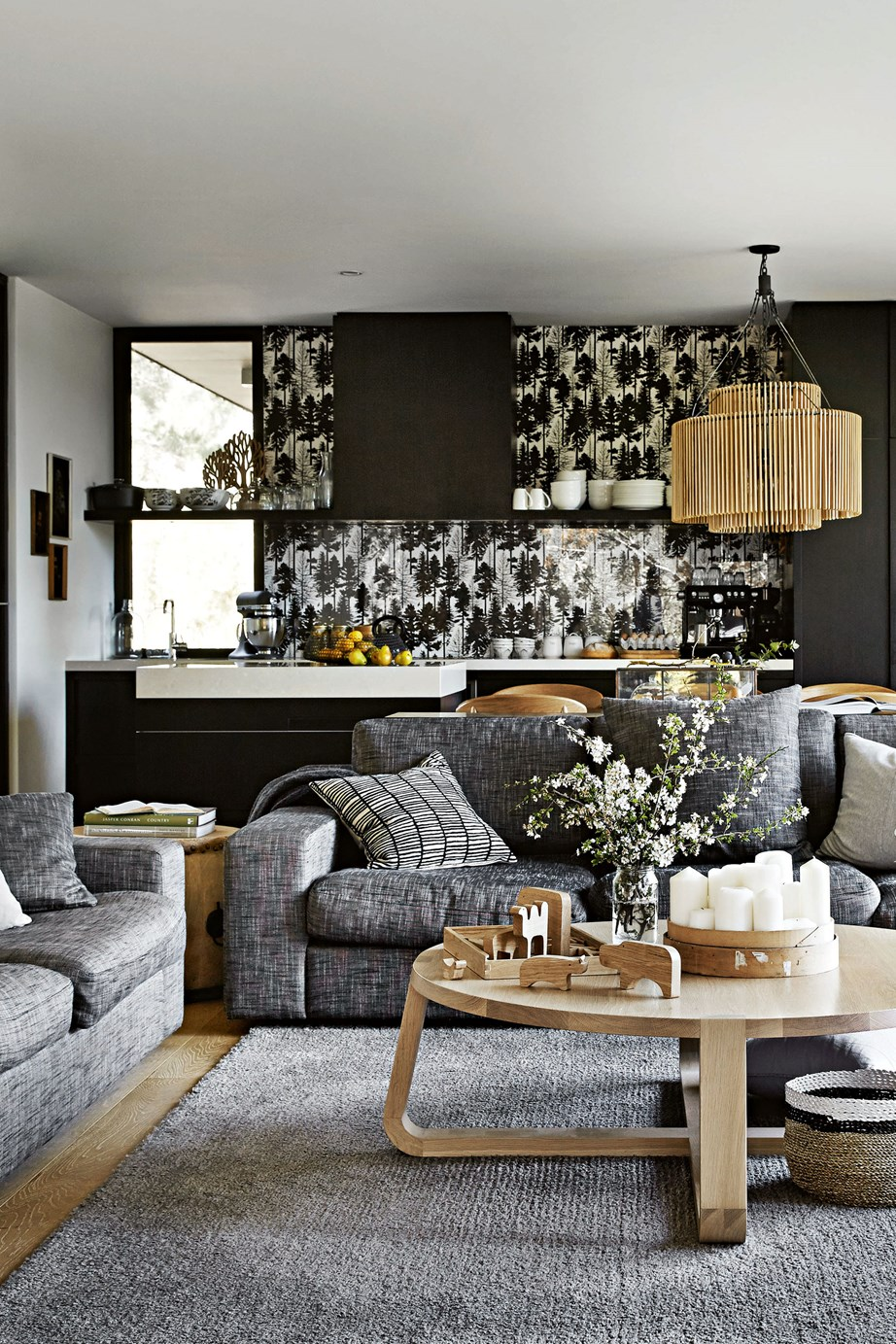 "Bespoke sofas and a 'Jade' coffee table from Zuster take pride of place in the living room of this [modern country home](https://www.homestolove.com.au/gabion-wall-country-home-13655|target=""_blank""). In the kitchen, the wallpaper spashback adds pattern and texture to the otherwise neutral room."