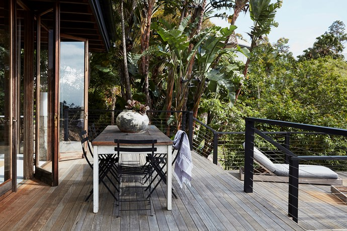 The family loves to dine and entertain on the multi-level deck. The pot on the table is from Graham Geddes Antiques, while the sun loungers were bought from Eco Outdoor.