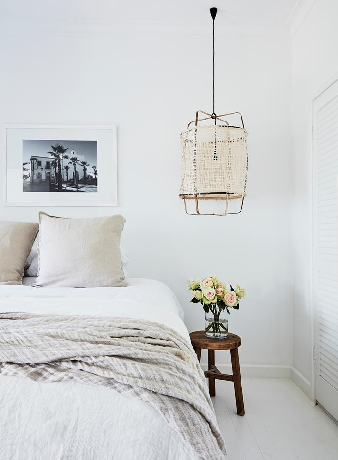"Each bedroom features a framed photograph Olivia took while on holidays. ""They trigger happy memories,"" she says. The bedlinen is Linen House, throw from Hale Mercantile Co and the stool is Bisque Interiors."