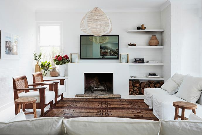 In the upstairs living area, seating is arranged in a way that encourages conversation – it's a particularly cosy set-up in cooler months when the fire is roaring. The shelves are decorated with items picked up during the family's travels.