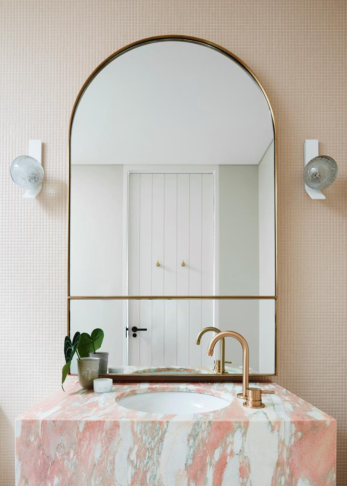 A pretty ensuite designed by Decus Interiors is ready for play but is able to act like a grown-up space as well. *Photograph*: Anson Smart.