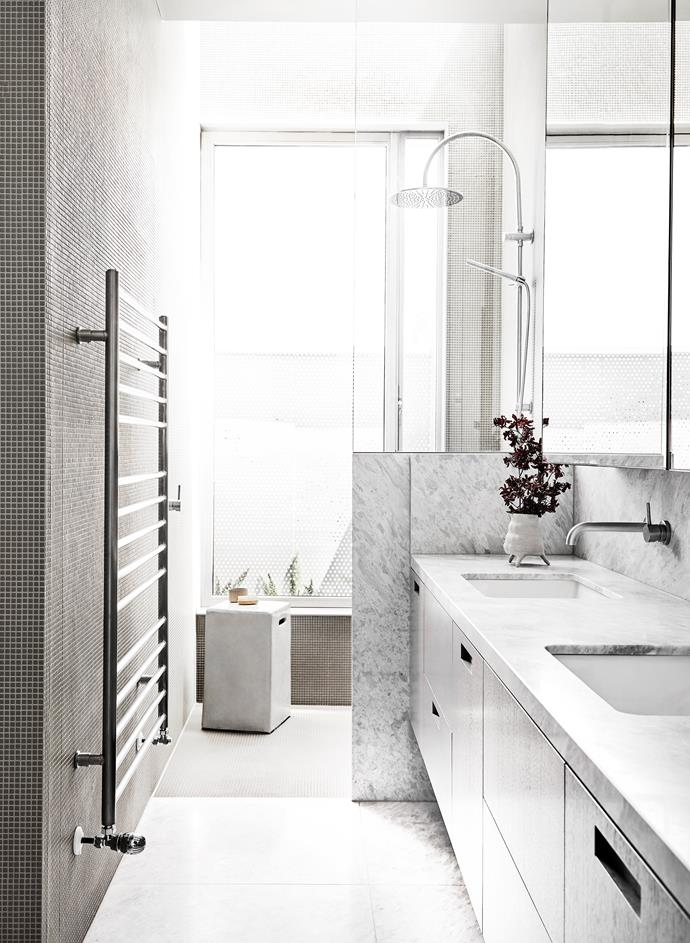 Light filters into this exquisite ensuite by Fiona Lynch, blurring the lines between in and out. *Photograph*: Lillie Thompson.