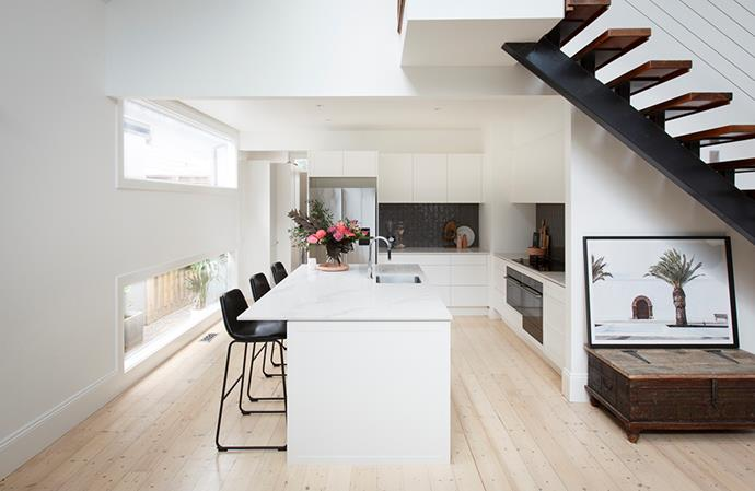 """Clean lines and a pristine white palette helps to create the illusion of space in this otherwise hidden entertainer's kitchen. *Image: supplied / [Kinsman](https://kinsman.com.au/