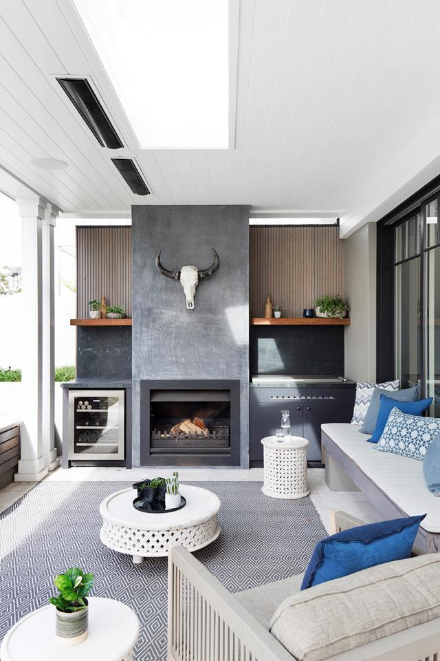 "The material palette of this [restored heritage home's](https://www.homestolove.com.au/sydney-1870s-heritage-house-restoration-6030|target=""_blank"") outdoor area includes timber shelves made from recycled rail sleepers, teak wall cladding, marble splashbacks and a fireplace in burnished black concrete. *Photograph*: Rosa Senese 