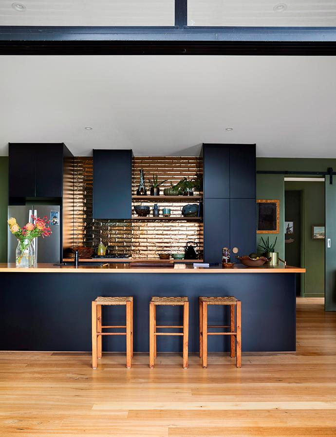 This entertainer's kitchen is all about making a statement. The standout feature? The bronze-tiled splashback. *Image: Armelle Habib / bauersyndication.com.au*