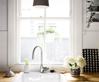 Timber kitchen with porcelain sink overlooking window