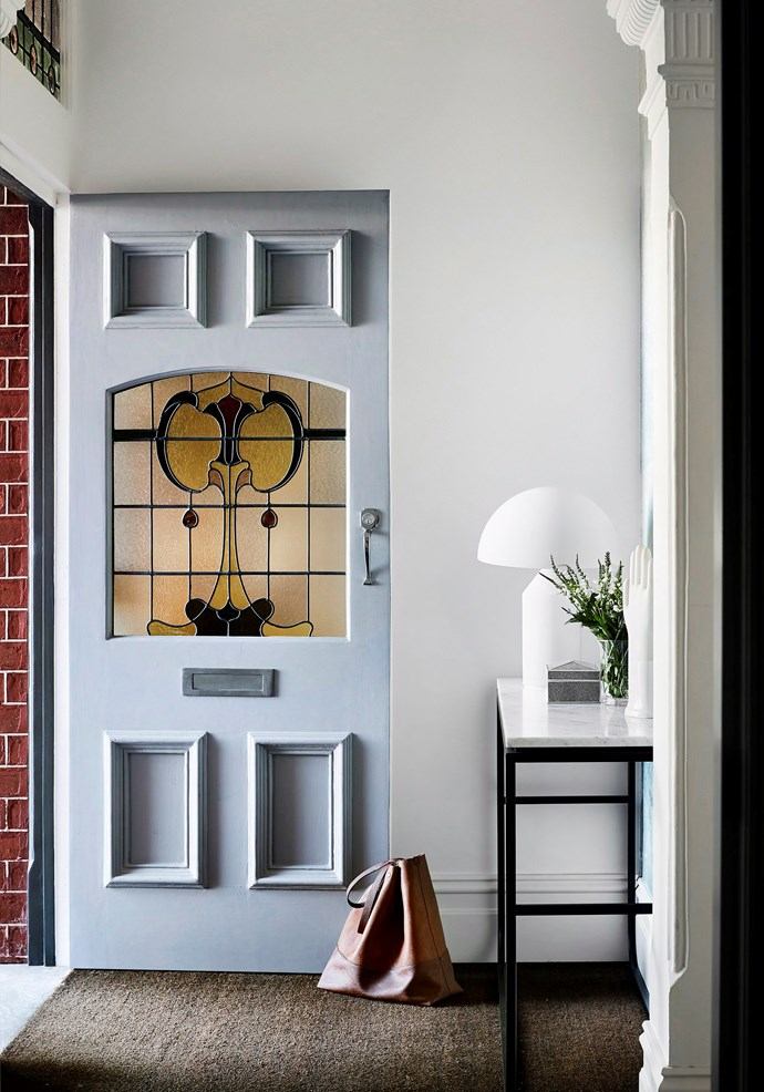 Even muted tones can create impact when it comes to updating your homes entry. Powder blue makes a soft statement combined with the original leadlight on the door of this classic Edwardian home. *Photo:* Tess Kelly / *real living*