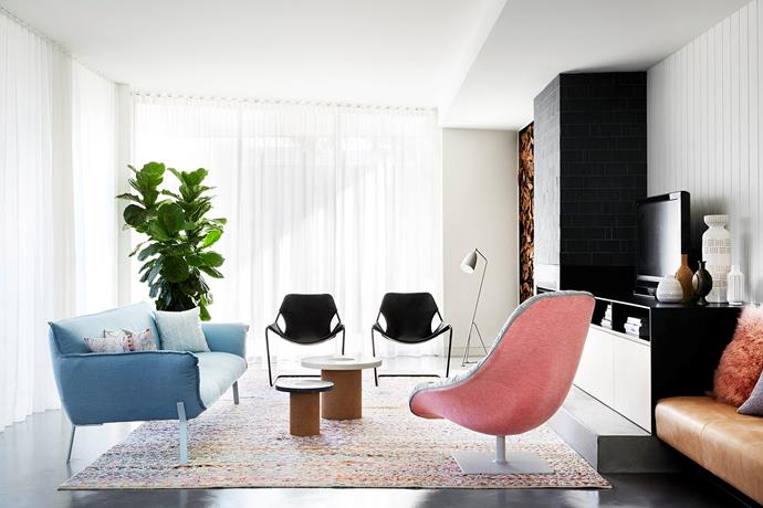 Grounded by a colourful Loom rug, the living room, with its pretty pastel-toned Bohemian armchair by Moroso, is designed for the owners' and their guests' downtime.