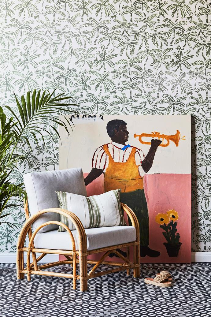 Embrace the colonial trend with cane furniture, linen cushions and jungle-themed wallpaper. Deco armchair in natural, $1199, Naturally Cane. Oxford cushion in Sage, $109.95, Eadie Lifestyle. *The Trumpet Player* artwork, $4500, Emma Gale.