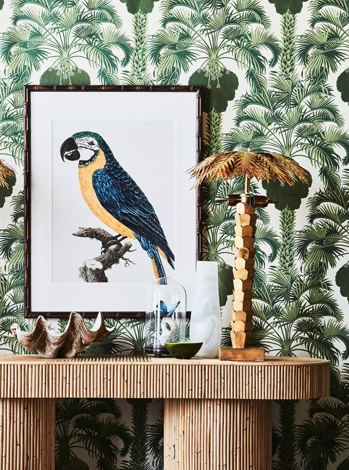 "**ON WALL:** Cole & Son ""Hollywood Palm"" wallpaper in Leaf Green, $340 for 10m roll, Wallpaper Trader. Perroquet V (green bird) and Perroquet II (blue bird) artworks in Faux Bamboo Brown frames, $655 each, Contents ID."