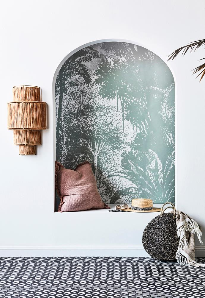 Raffa wall sconce, $295, Tigmi Trading. Lost in Goa Jungle wall mural in Grey, $300 for 3m roll, Wallpaper Trader. Chelsea cushion in Musk, $109.95, Eadie Lifestyle. Rio round woven beach bag, $89, Arms Of Eve. Portofino throw in Natural, $319, L&M Home.