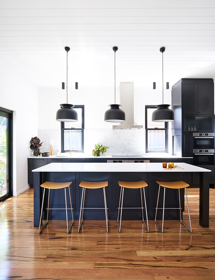 """Matte black cabinetry teams well with the minimalist aesthetic of this contemporary entertainer's kitchen. *Image: supplied / [Kinsman](https://kinsman.com.au/