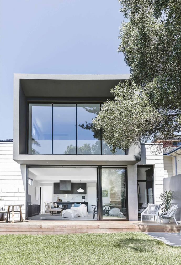"""**Exterior** The view of the house from the back garden shows its linear design. """"We love the grey exterior,"""" says Sarah. """"The house has such a boxy, modern appeal.""""<br><br>*Contact Sarah at [Sarah Woods Design](http://www.sarahwooddesigns.com.au/