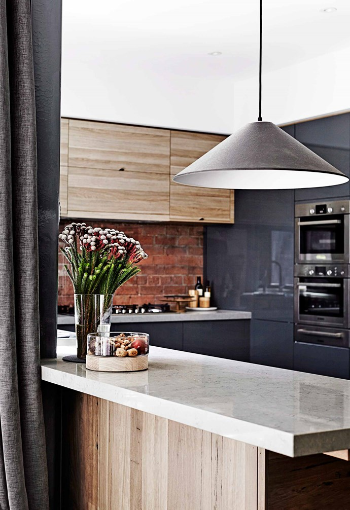 """**Another brick in the wall** Exposed bricks are a common design feature when it comes to industrial interior style, and here, Kyal and Kara incorporated the red brick splashback beautifully into this contemporary kitchen. *Design: [Kyal and Kara](http://www.kyalandkara.com/ target=""""_blank"""" rel=""""nofollow"""")   Photography: Sharyn Cairns / bauersyndication.com.au*"""