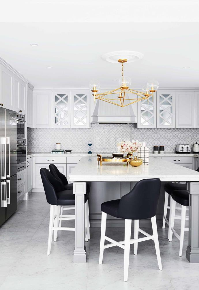 """**Irregular shape** Who said tiles could only have straight edges? The marble fish scale tiles in this kitchen add a soft touch to the french provincial inspired space. *Design: [Greg Natale](https://www.gregnatale.com/