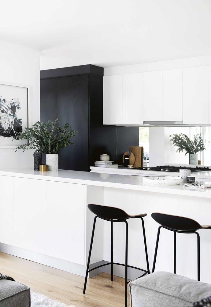 "**Mirror, mirror** Mirrors can make a surprisingly excellent kitchen splashback mostly due to the fact that not only do they help [enhance your home's natural light](https://www.homestolove.com.au/how-to-increase-natural-light-in-home-15836|target=""_blank""), but they also have the visual effect of elongating the space like in this [monochrome Northern Beaches home](https://www.homestolove.com.au/step-inside-this-monochrome-northern-beaches-home-17911