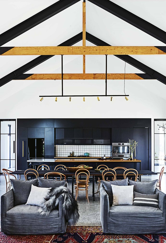 """**Square dance** Playing on the popularity of white subway tiles, the kitchen in this [cosy country farmhouse](https://www.homestolove.com.au/step-inside-this-cosy-country-farmhouse-with-modern-interiors-17468 target=""""_blank"""") subverts the trend with white square tiles paired with black grout. The white tiles pop against the black cabinetry and timber benchtops, adding a contrasting visual element. *[Build & Design: Green Apple Interiors & Design](http://greenappleid.com.au/ target=""""_blank"""" rel=""""nofollow"""")   Styling: Jono Fleming   Photography: Anson Smart*."""