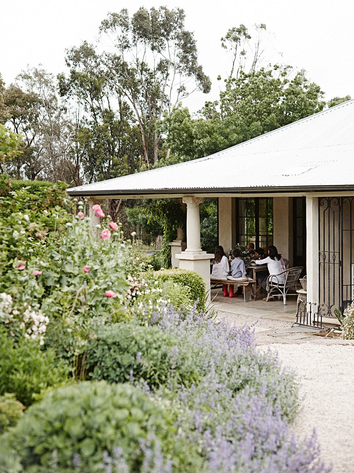 "[Deep verandahs](https://www.homestolove.com.au/country-verandahs-13365|target=""_blank"") were added some 80 years after the original cottage was built. ""The Adelaide Hills are quite close to the city, and yet the area has its own culture and a nice sense of community involvement,"" Andrew says. ""It's such a good balance living here."""