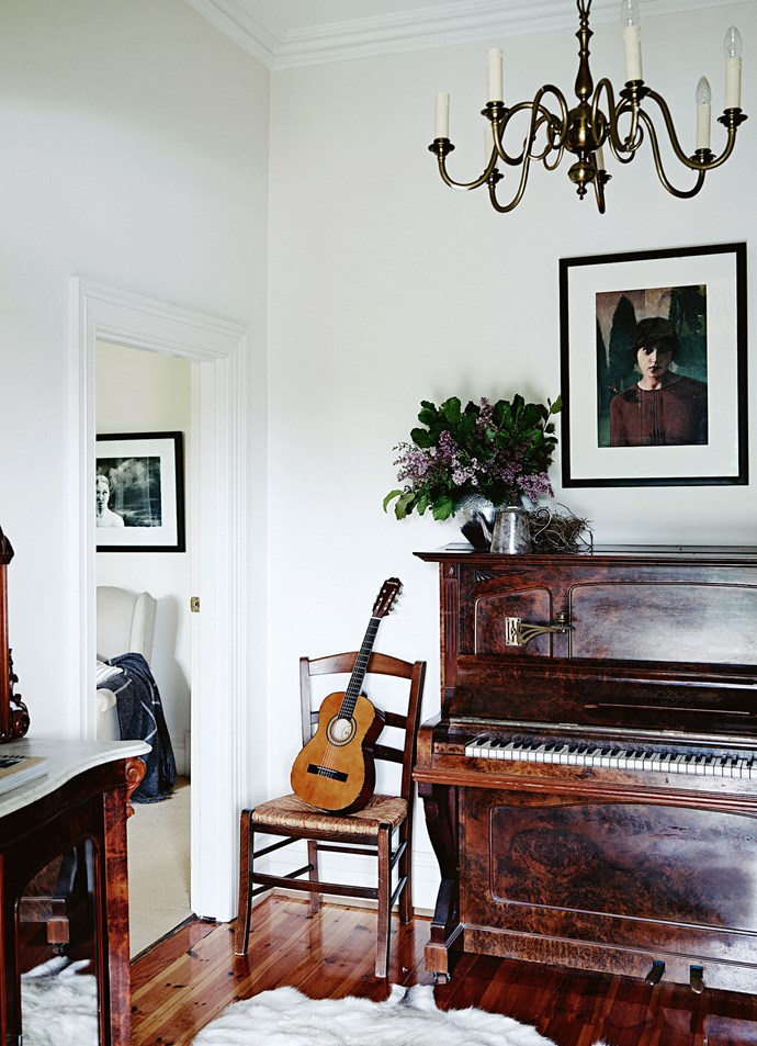 "*Emanuelle* by Adelaide-based artist Megan Roodenrys hangs above the piano. The original [farm cottage](https://www.homestolove.com.au/flower-farm-property-victoria-18945|target=""_blank"") had been built in the 1880s. Around four decades later, it was given bungalow-style additions, with deep verandahs and a lean-to kitchen at the rear. ""Inside it was a rabbit warren of little rooms,"" Susie says."