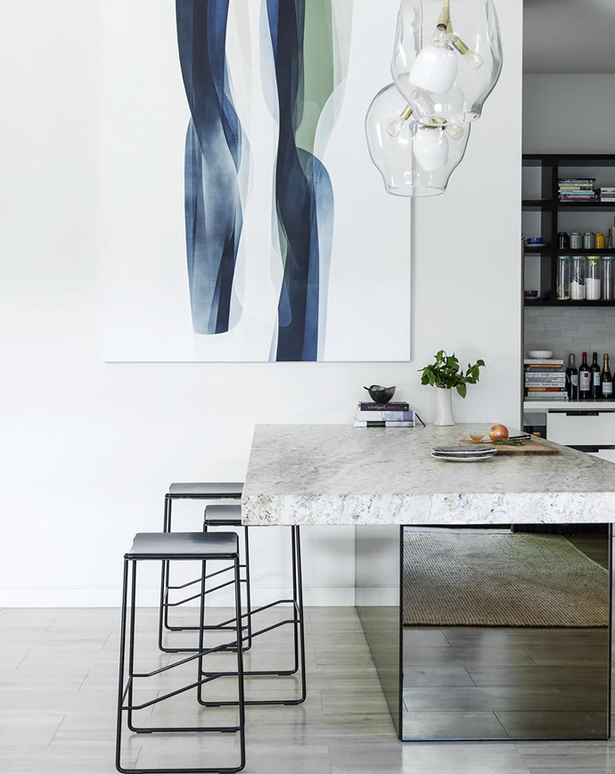 Alice and Danny opted for a solid slab of 'Bianco Antico' granite from Zuccari for their bench. It has a bronzed mirror base. Ebonised overhead cabinetry is 'Metro Recon' veneer in Black Gold from Amerind. Splashback, Academy Tiles. A pantry/laundry is tucked away just off the kitchen.
