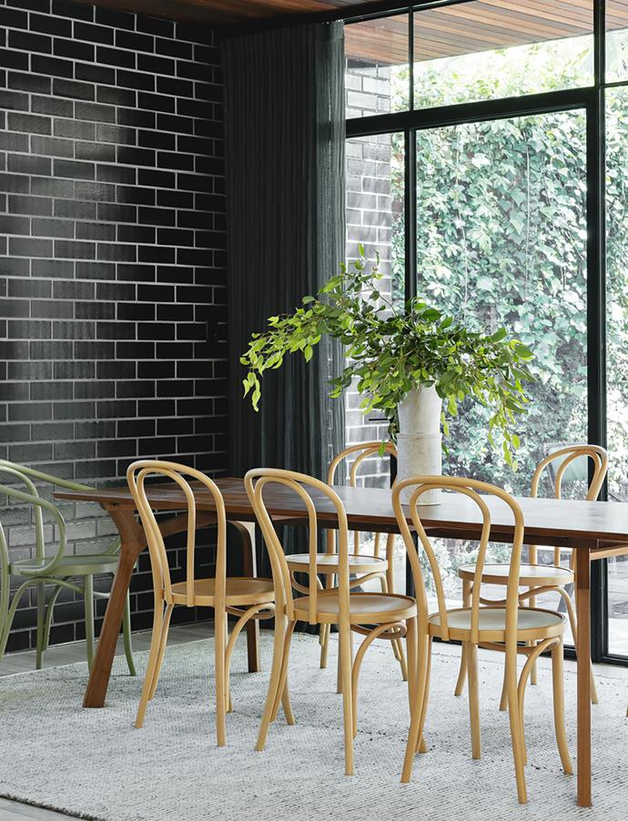 "Chairs in a natural finish and customised 'Corbusier' end chairs from Thonet are positioned around a 'Lyssna' dining table by Melbourne firm Tide Design. ""We asked for it to be narrower and therefore more intimate,"" says Alice."