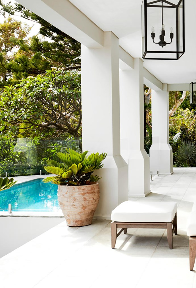 On the newly created pool terrace is outdoor furniture from Janus et Cie, and a terracotta pot from Garden Life. 'Crown' pendant lights from Dunlin.