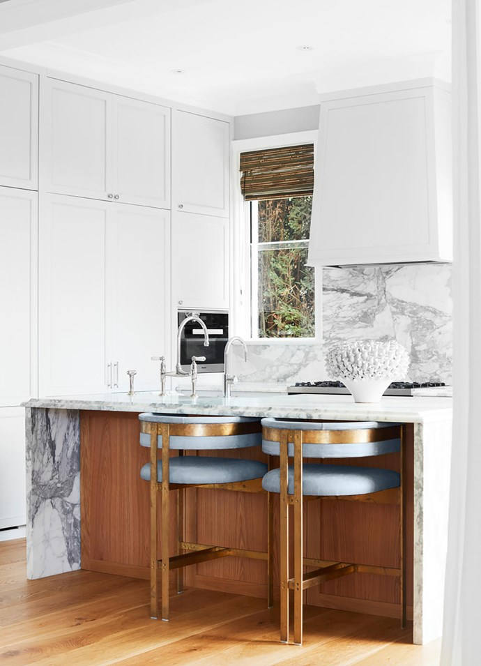The kitchen bench and splashback is in Arabescato marble from Harmony Stone Gallery. Tap from The English Tapware Company. Custom bar stools in leather and brass.