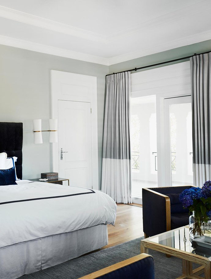 The master bedroom has a custom velvet bedhead and curtains in a Boyac linen. Custom coffee table by Adam Hart. Chair from The Country Trader. Robyn Cosgrove rug.