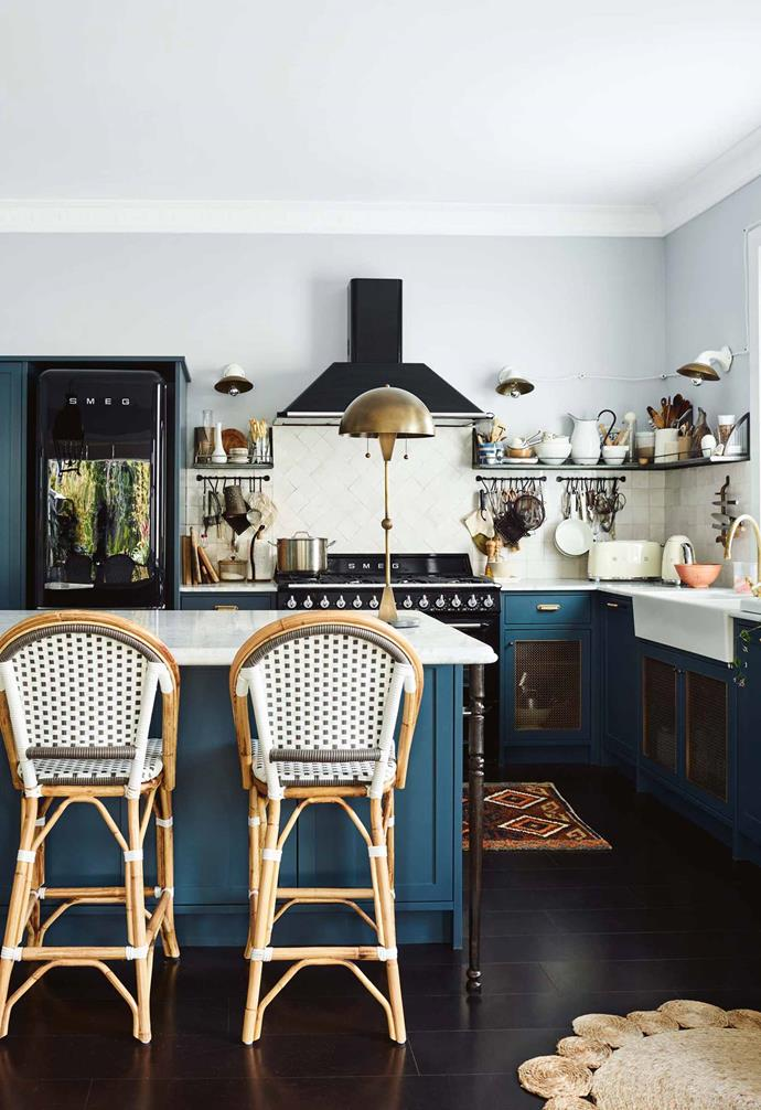 "The kitchen features [teal cabinetry](https://www.homestolove.com.au/kitchen-cabinets-your-guide-to-choosing-right-5610|target=""_blank"") and [marble benchtops](https://www.homestolove.com.au/kitchen-benchtop-guide-19237