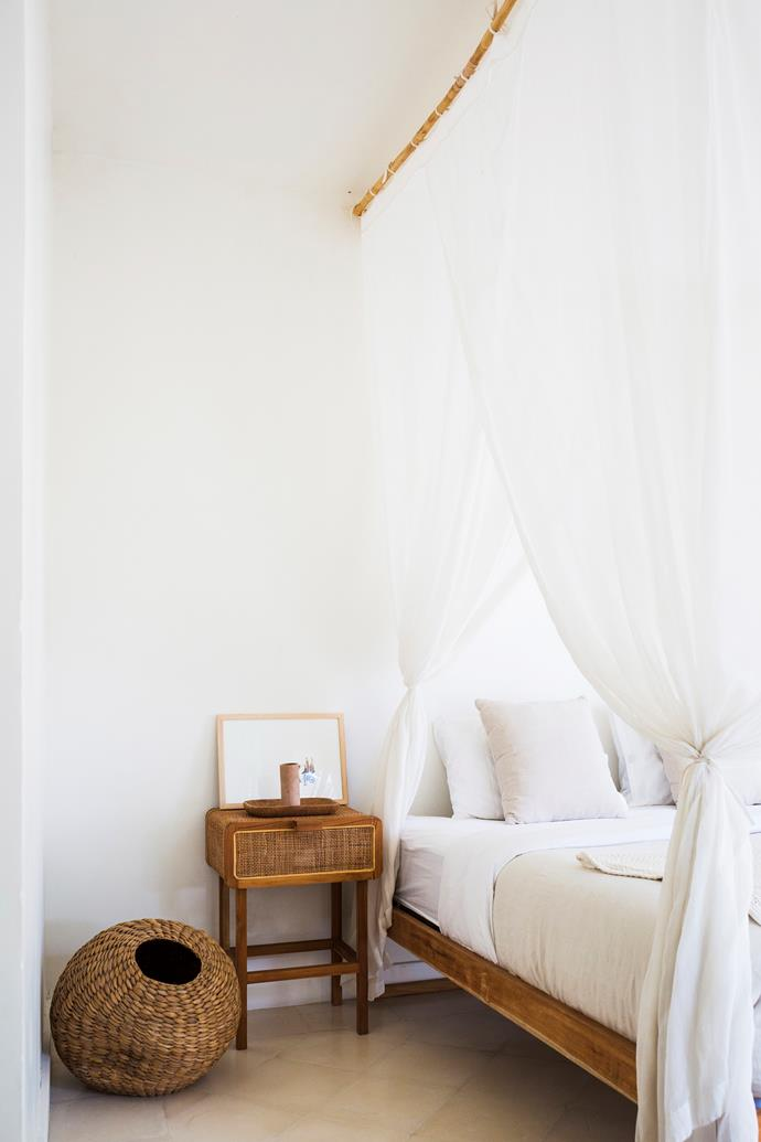 """""""We kept the guest room very simple – a drawer, a chair, a basket and that's it. We wanted to focus mostly on the view beyond the sliding doors, which opens out into the pool and garden."""""""