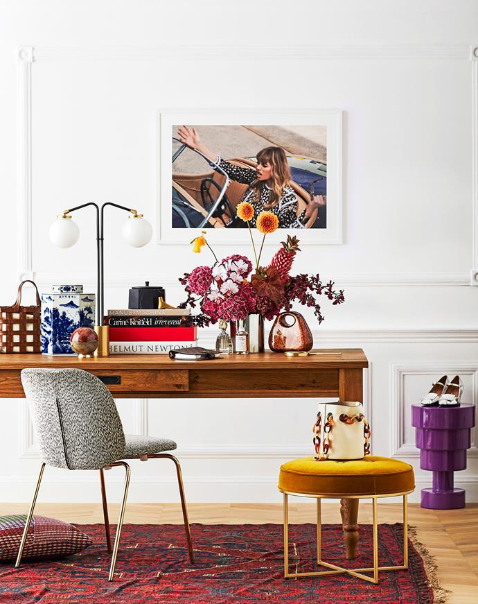 "Trentham dining table, $999, Lounge Lovers. Arflex ""Corelle"" chair in Snake/Gold, $1850, Poliform. Clifton buttoned round ottoman in Gold, $695 for small, Coco Republic. CTO Lighting ""Array"" twin table light, $2695, Spence & Lyda. Jessica photographic print, $639, Margaret Zhang, in Custom picture frame, from $10, Frameshop."