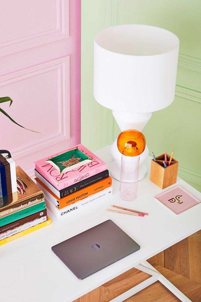 "Ichendorf Milano ""Kokeshi"" bottle, $220, Jardan. Cuzzi II table lamp, $390, MCM House. Apollo tray in Pink, $52, Jardan."