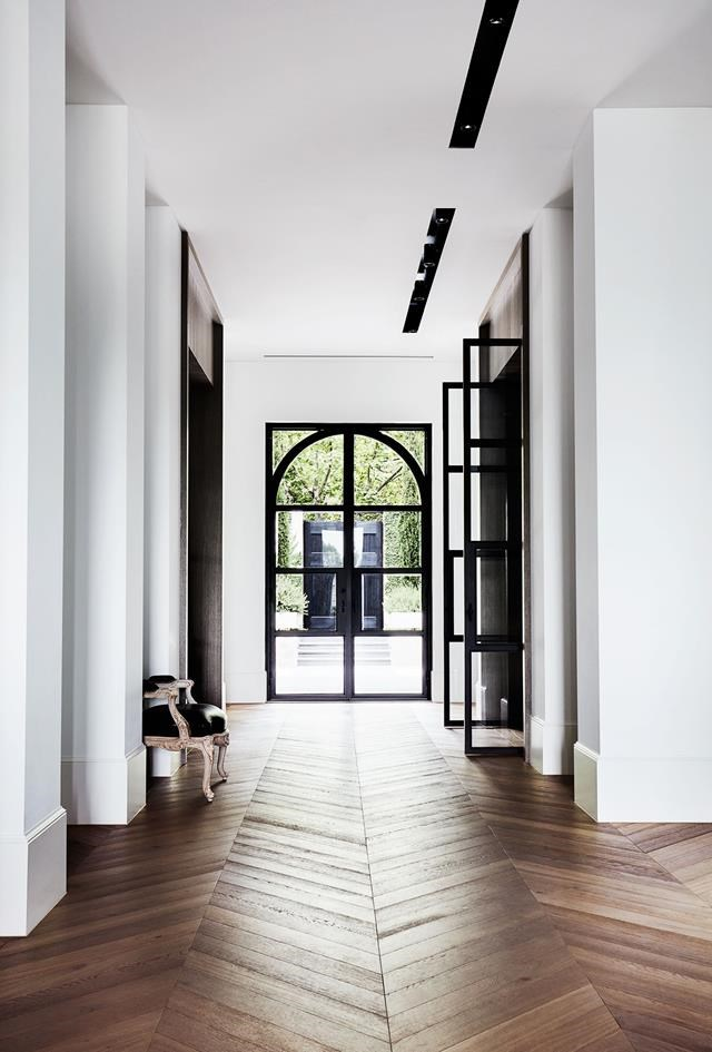 """A muted palette of alternating black and white rooms lends a pleasing rhythm to this [stylishly understated house](https://www.homestolove.com.au/melbourne-home-with-french-and-belgian-influence-6435