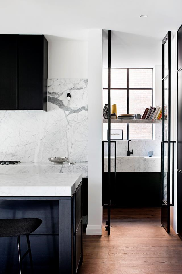 """Classic yet contemporary, creamy marble complements matt black fixtures in this [monochromatic kitchen](https://www.homestolove.com.au/family-home-reinvented-with-classic-contemporary-style-6793