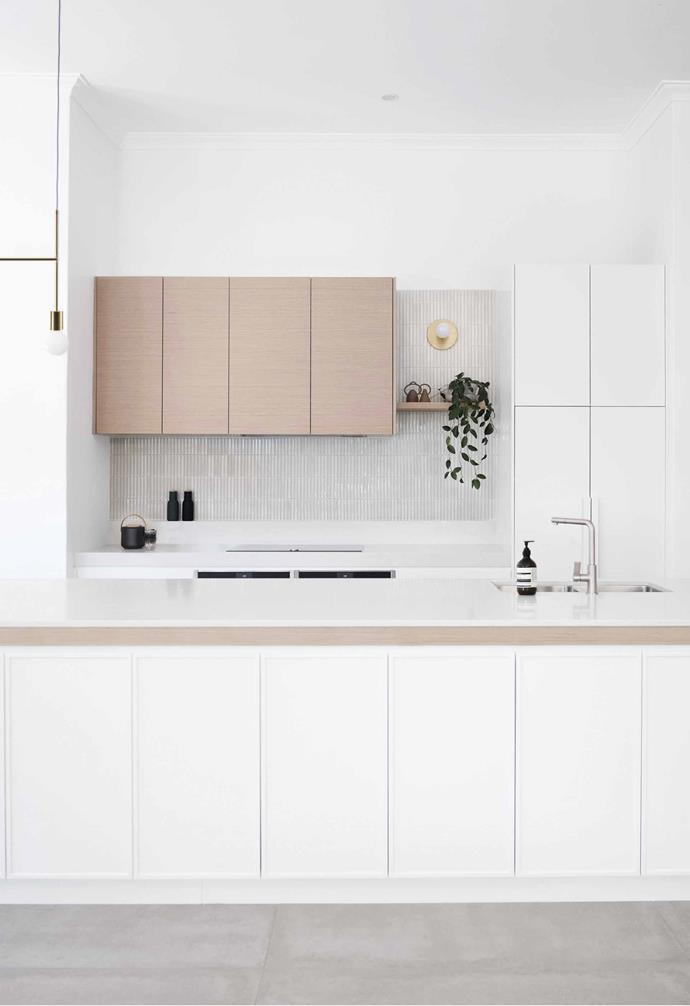 **Cabinetry** Extensive storage was added to the kitchen with ample cupboard space both in the kitchen island and around.