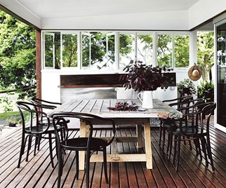 Outdoor dining space on an enclosed outdoor deck