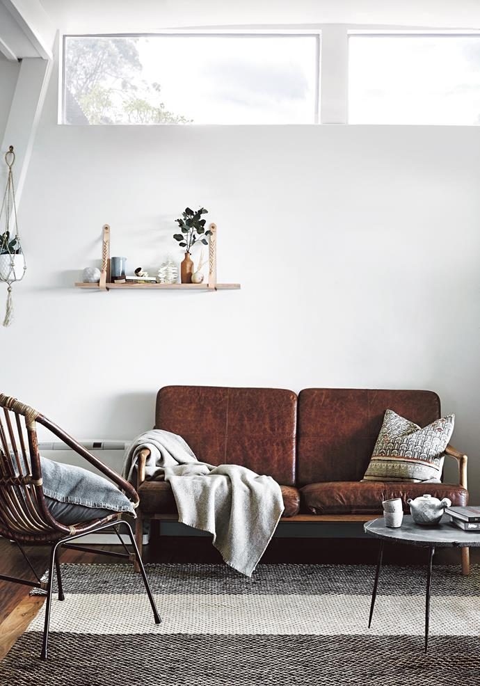 "A leather sofa and 'Rattan Barrel' chair from [The Shelley Panton Store](https://shop.shelleypanton.com/|target=""_blank""