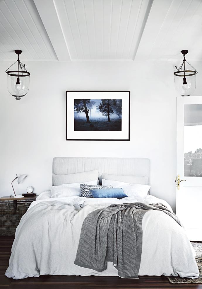 "A Mark Lobo 'Ritual' print hangs above the bed, swathed in [Abode Living](https://www.abodeliving.com/|target=""_blank""