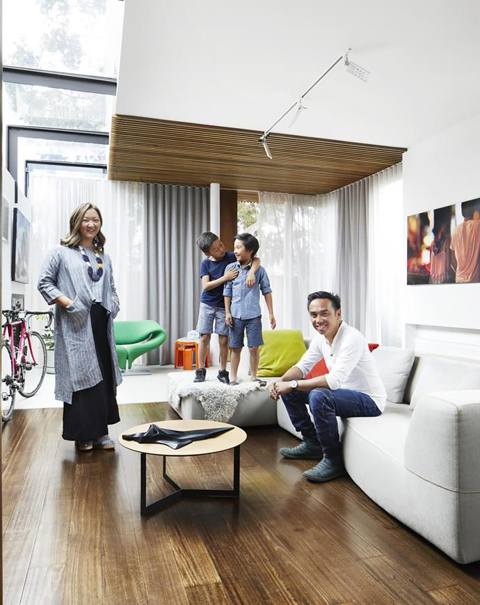 Owners Susan and Michael encourage sons Jasper (left) and Mannix to use all the furniture in this art-filled space. In fine weather, they open the curtains and let the full-height glazing bring the green of the garden inside. B&B Italia 'Bend' sofa by Patricia Urquiola, Space. 'Kabi' coffee table, AJAR Furniture & Design. Track lighting, Artemide. 'Niche' sculpture on table by Zaha Hadid for Alessi. Artwork (right) by Vincent Fantauzzo.
