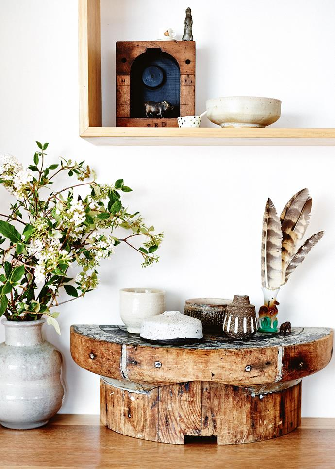 Each piece of furniture and every ornament tells a story that Carmen loves to share. A wooden pipe mould is topped with ceramics by Tasmania's Sallee Warner and a jar containing feathers from masked owls that Carmen Blyth used to care for. On the shelf above, a bronze pig from Tasmania's Margate Train Antiques sits inside another pipe mould.