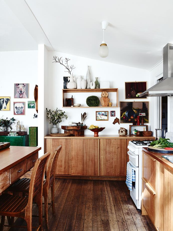 "Carmen renovated the [timber kitchen](https://www.homestolove.com.au/modern-timber-kitchen-by-fabrikate-creative-spaces-5185|target=""_blank"") with the help of a boat-builder friend skilled in wood working. The timber is all recycled from Tasmanian oak cupboards found at second-hand shops. ""I collected all the wood,"" says Carmen.  ""It's so much cheaper than installing a new kitchen. I had an idea of what I wanted which, like everything I do, evolved."""